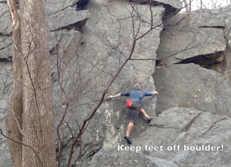 """The Carderock Low Traverse climbs the boulder problem """"Shinbone"""" across this face and around the corner. Even though it looks like I'm standing the the boulder, my feet are actually on small holds on the main wall."""