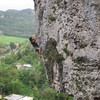 """Luis Benet engaged on the upper half of the fun route """"My Right Foot"""".  I prefer to clip the first two bolts in the roof then it makes the most sense to climb straight up, skipping the third bolt in the roof (contrived) and f"""