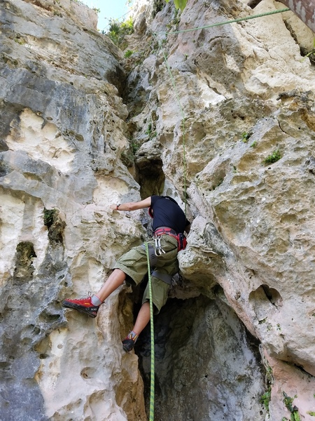 """Audi at the start of """"La Otra Esquina"""", listed in the guidebook at 5.9, this is a fun 5.7 that is very vegetatef but worth doing and easiest route on cliff."""
