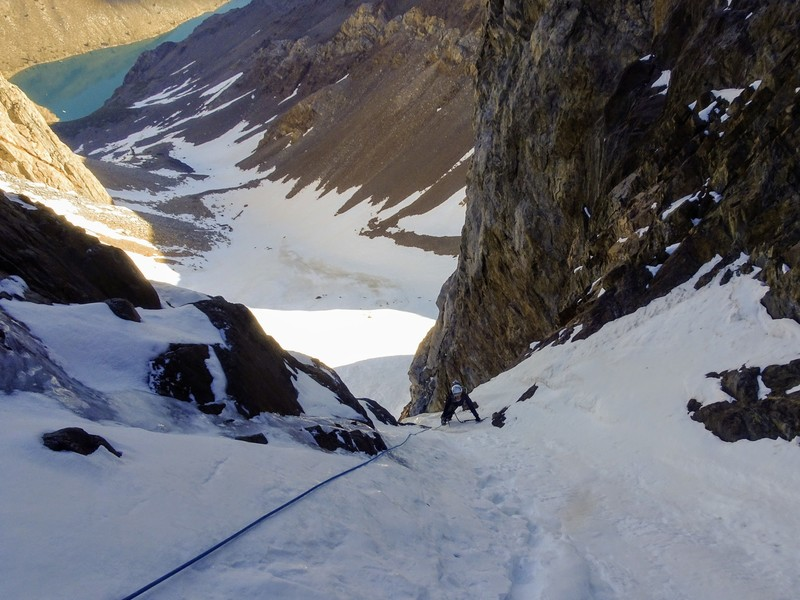 Natalie over the ice and into the couloir proper on our 80m entry pitch (we simuled a fair bit with a 60m rope). Convict Lake top left