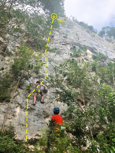 Climber at the start of La Escalera.  This is currently the only route with lower-off locking carabiners at the top of the pitch.  It's a steep anchor clipping spot so consider clipping in with a quickdraw or PAS first to use