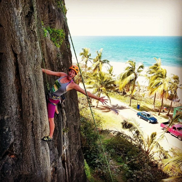 Adi Carter enjoying another lap on Hump Day at the Puerto Playa Hermina crag.