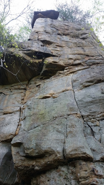 climb the left crack system through roof to the arete at top