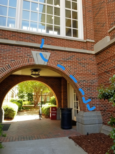 Twins. There are also brick edges on the inside of the archway. gray ledge above trapezoids is sloped.