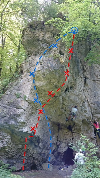 The prow on the left with Hollfelder Weg following the blue line. The red line is a hard 5.11. The climber in white is climbing Höhlenweg, a 5.10. The girl is climbing Verschneidung, a 5.7.