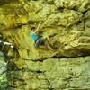 "A climber enjoying the great moves of ""Smokin' Break"" 5.11-."