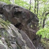 Another angle of the same boulder. The lines are obscured by the rocks in front, but the face is climbable.