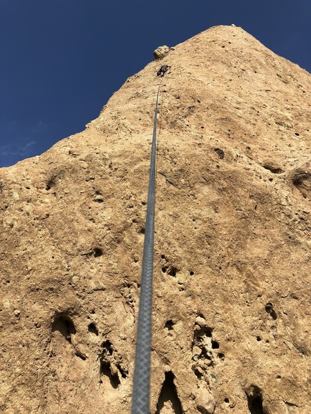 Taylor getting ready to clean the anchors of Dixieland. The route wanders to the left as the start is way to the right near the arete.