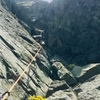 """Steve heading into the """"crack"""" which is really a narrow chimney mixed with face climbing to the left of it."""