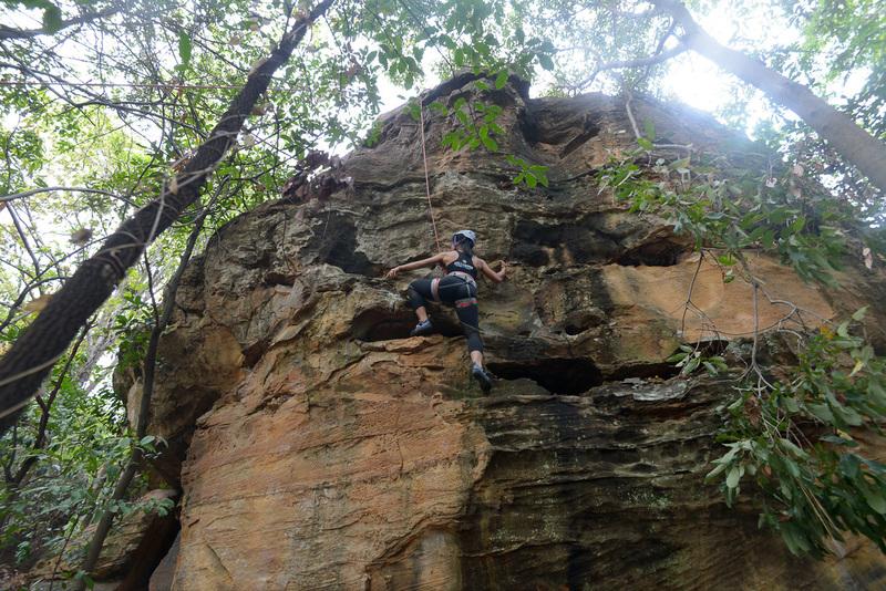 Climbing on Smash, 5.8, the hulk boulder.