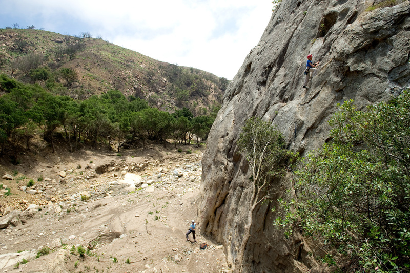 San Ysidro - May 28, 2018<br> Wesley Fienup climbs the start of Face Lift. The crack along the first 20 feet of the route is packed with mud, making it feel slick and insecure. Above the oak tree that now rests against the wall, the rock quality is fine.