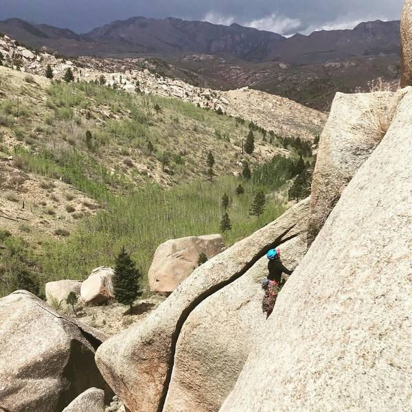 Jess finishing up. The obvious crack to the left is unclimbed. #4s.