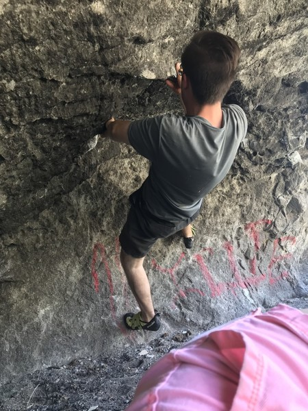 climber shown is two moves into soft palate, the start of the route can be found very easily, look for the big chalky holds near the right side of the cave. Then follow the chalk marks that head up and to the right.