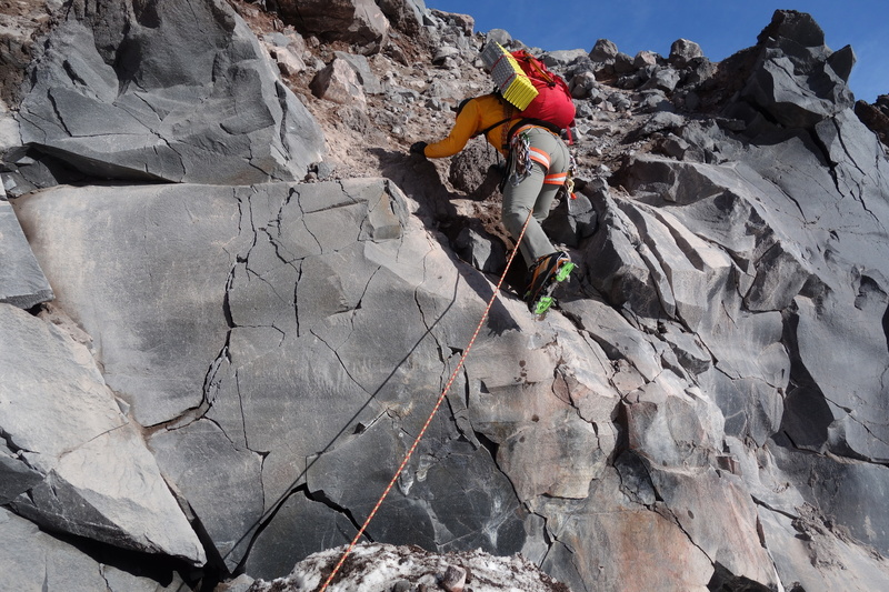 We had to do a boulder problem to gain the ridge right at the toe.  Thankfully, all of the holds are loose and there is a monstrous crevasse waiting to swallow you if you fall off this thing.