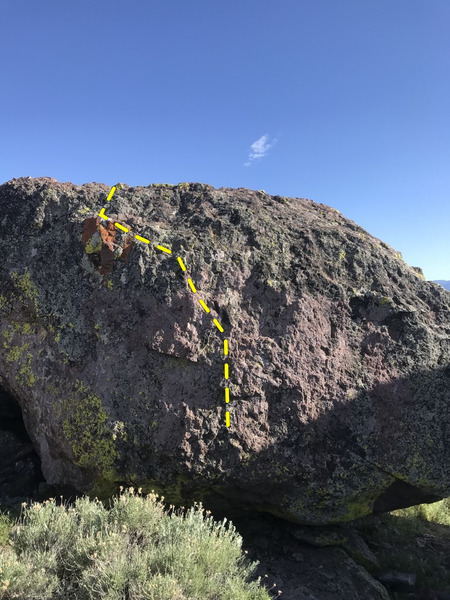 starts in the middle on small holds, and makes it's way to the white tipped rock at the top.