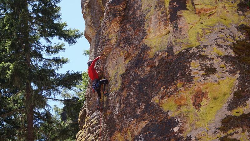 Daniel climbing Mystic Monkey (5.9) on the Fire Dome