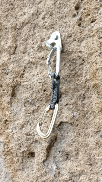 """You know the old saying about gear left on routes """"check it before you use it"""", well it certainly applies here after the massive Brian Head fire of 2017. Here's a quickdraw left on a route at the lower tier of Principality with a scorched dogbone."""