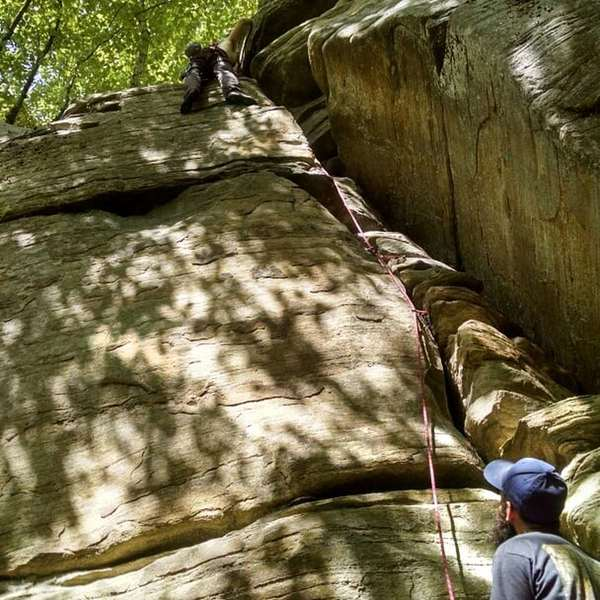 Working towards the top, just past the crux move.