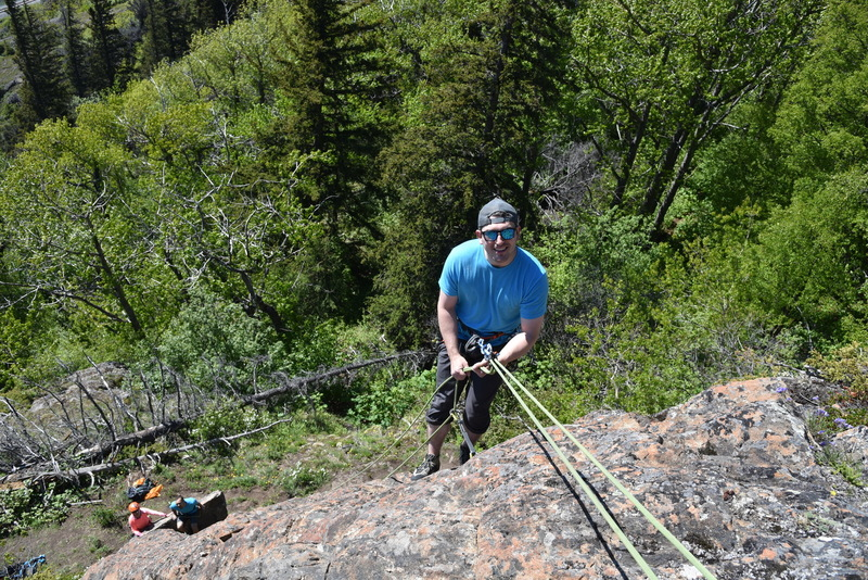 Matt cleaning the route as Darlene and Spenser enjoy a sunny Alaska day in the belay area.
