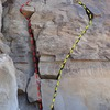 The direct start to The Queen of Shangri La is the left arcing finger crack (yellow line) for an easier start climb the variation The Princess of Shangri La (red line)