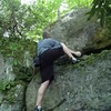 Jake Dacus nailing the first ascent of High Step Scramble.