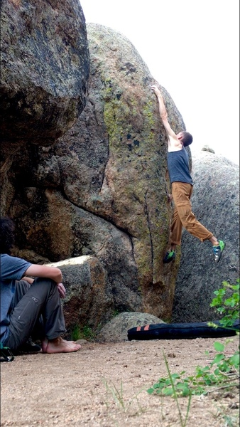 Sticking the huge left hand throw on problem 13. Despite the little lump of rock underneath, the fall is super comfy.