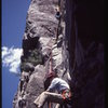 The first ascent of the Front Nine, early 1980s, first route at the Pool Wall.<br> <br> Photo by Bill MacTiernan.
