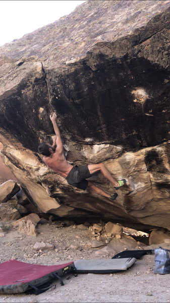 Moving into the crux sidepull of Red, V9.