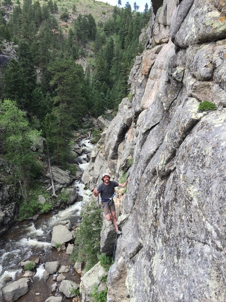 Tom at the top of P1 taken from Divination P1 belay.