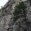 Climber near crux 2/3rds up P1.