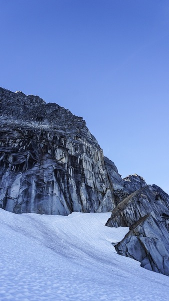 Looking up at the base of the climb. You can see footprints leading to the moat crossing and start of gully scramble/p1