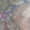 These two solid placements exist before the first bolt, about 12 feet up and close to the arete