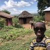 One of the kids from the Manyata. The route is up the hill from directly behind the camera.