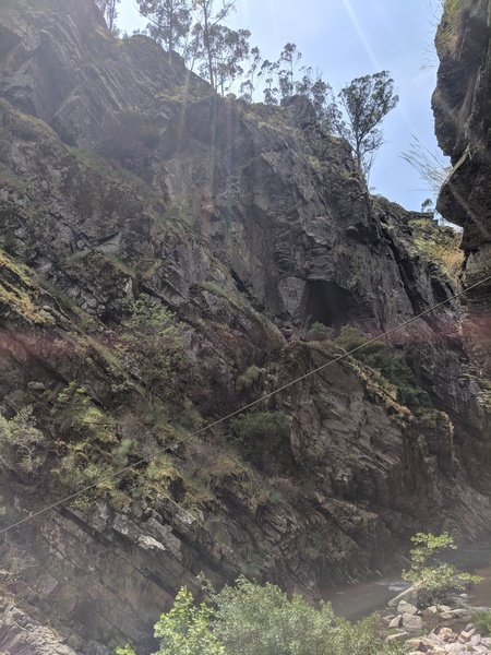 The lighting wasn't great, but you can see the cave and some of the climbs on the near side of the river.