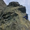 MF direct starts with face moves on the arete and then follows the rope up from the climber in this photo.