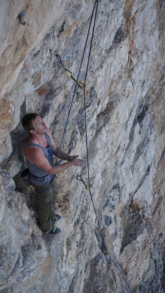 Cory stares down one of the new 30 meter routes at Superfly sector - Summer 2018