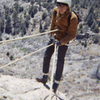 Mike Roybal rappelling off Pulpit 1968