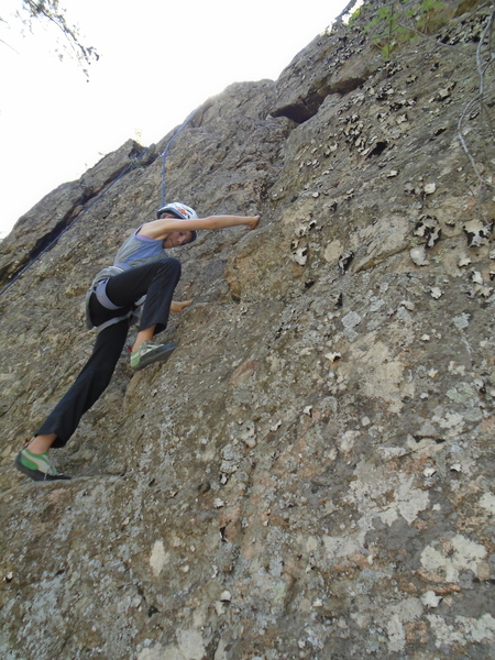"""Brooke (age 11) on the opening moves of Trenchtown (she is actually climbing the outside of the """"trench,"""" a wide, jagged crack, though it is not visible from this angle."""