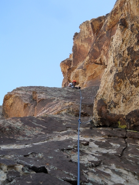 The final ramp of pitch 5, leading to the larger belay ledge