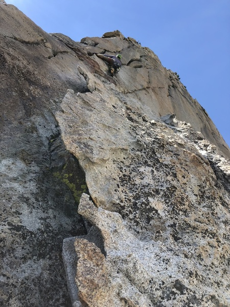 Evan heading up to the twin cracks, belaying from big flake with horns.