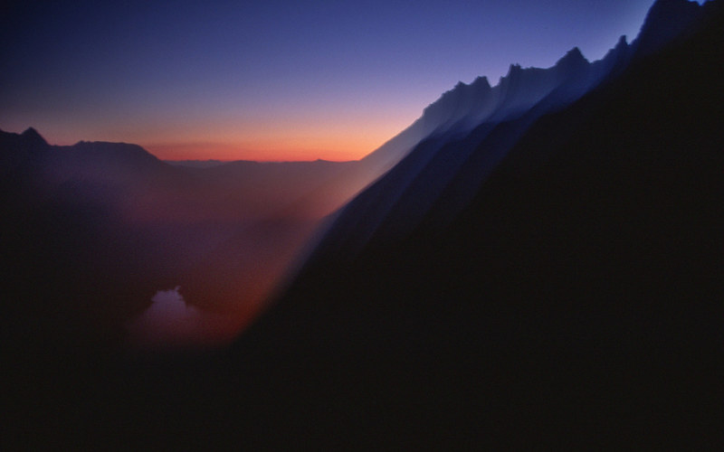 Pre-dawn glow on the approach to the Backbone Arete in August 2004. Very warm night. High 90s down in town.