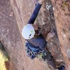 Moving through the crux on the FA. (Photo: Giselle Field)