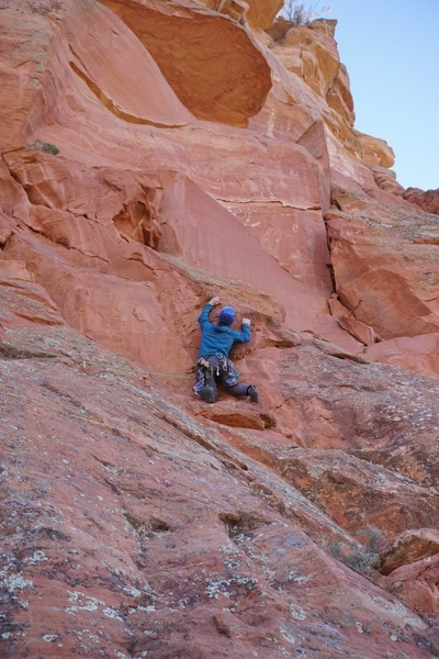 Andy leads through the crux on the FA.
