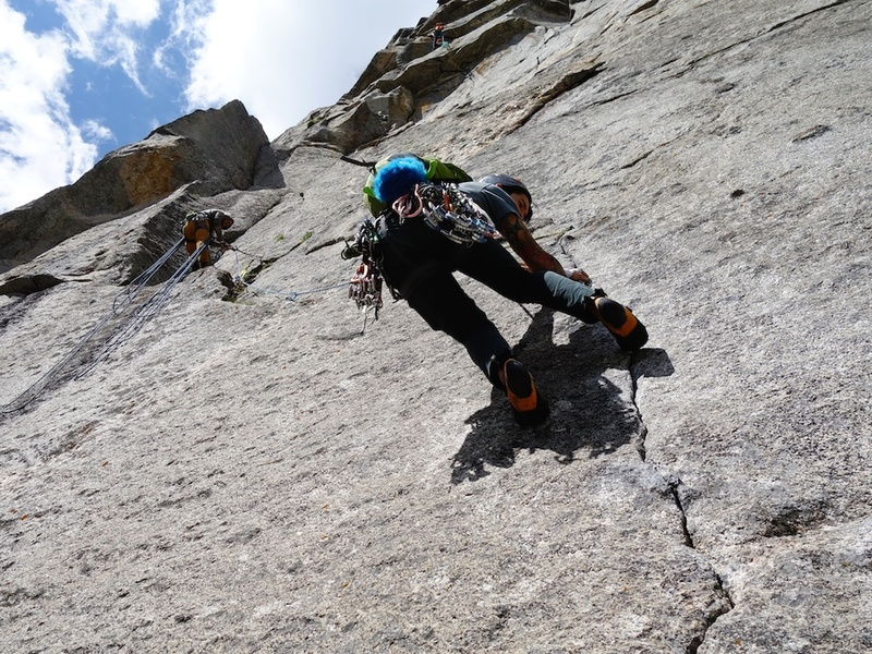 Climber following the crux on pitch 1.