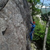 """RW about 15 ft up the """"far right"""" line. This starts in a corner on the path up,15 ft below the usual base area.  Top roping the route from the bolts you should put in a directional (#2 Gold, Camalot) on the Arete, or face a bad swing."""