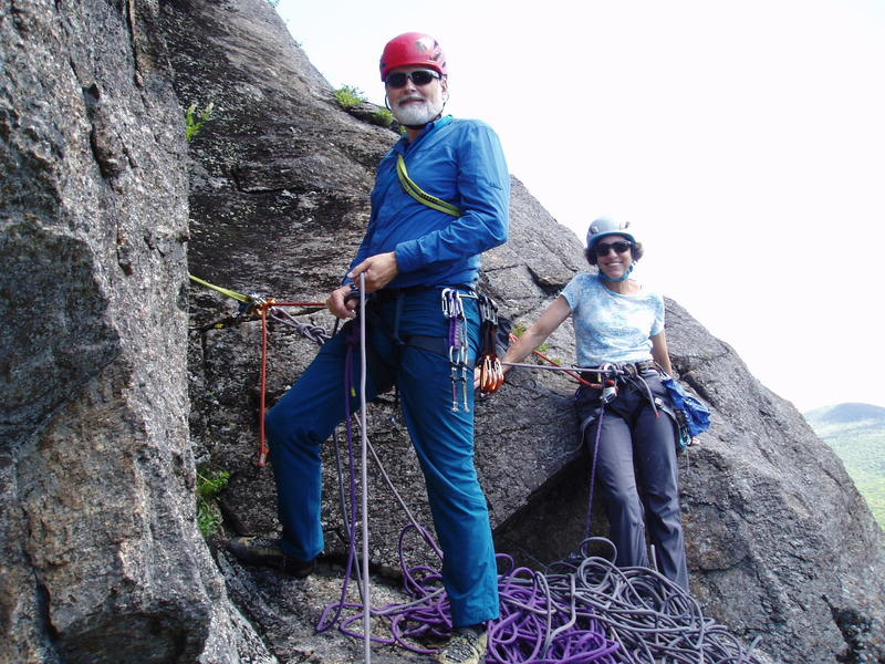Ralph and Sheila at the belay, end of P1 Right Side Route.  Remnant of an old piton in the horizontal behind Ralph. Key piece is a Red (#1) Camalot.