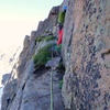 Table Ledge. The climber is at the top rap station for the rappel route.
