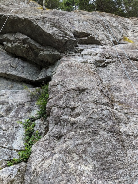 Deceptive is shown between two other routes with ropes on them.