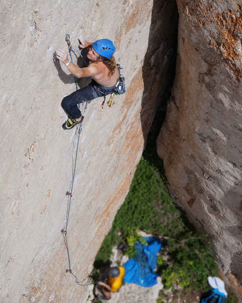 An unknown climber (I think Will?) on the opening crux sequence of Tribal War.