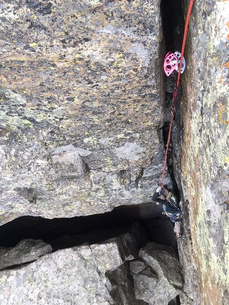 The final wide crack on Portal. A number 5 (or old 4.5) Camalot can be placed/bumped about four times on this pitch, supplemented by small pieces and slung chockstones. We thought the hardest moves were at the start of the wide crack, below the climber.